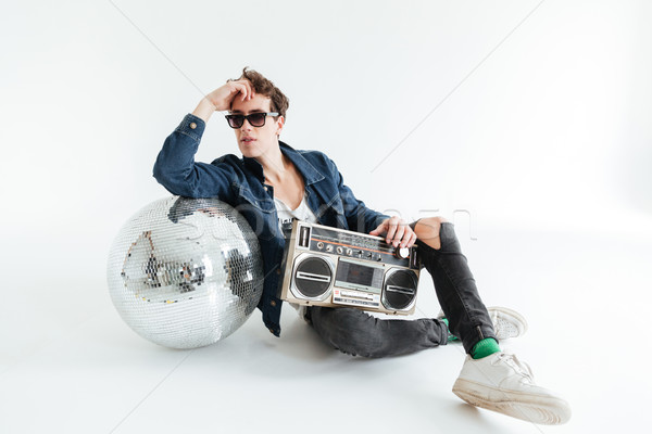 Handsome young man with disco ball and boombox Stock photo © deandrobot