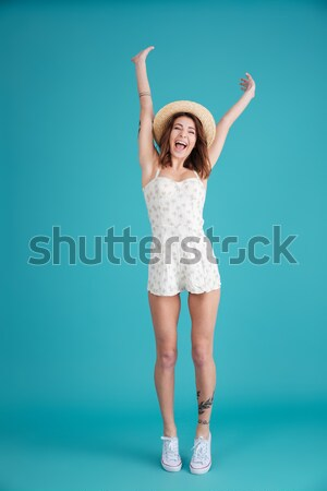 Young screaming woman standing isolated Stock photo © deandrobot