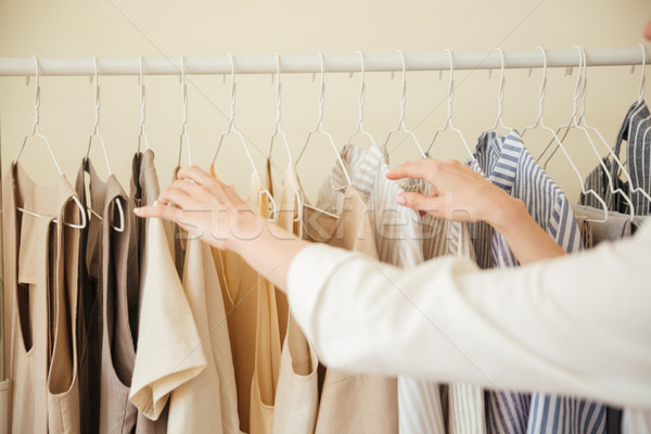 Close up of clothes hanging on rack Stock photo © deandrobot