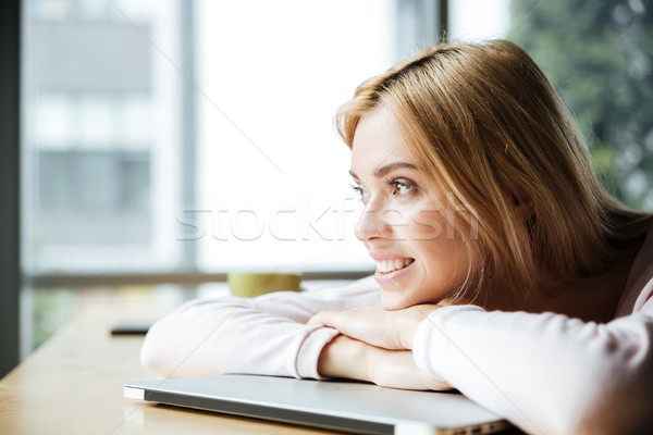Happy lady lies on laptop computer. Stock photo © deandrobot