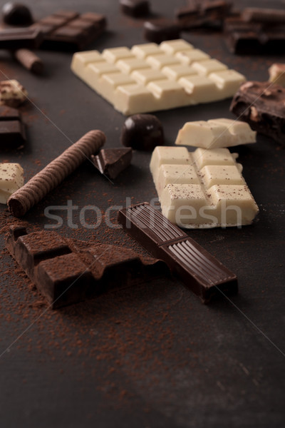 Mix of chocolate bars and candies Stock photo © deandrobot