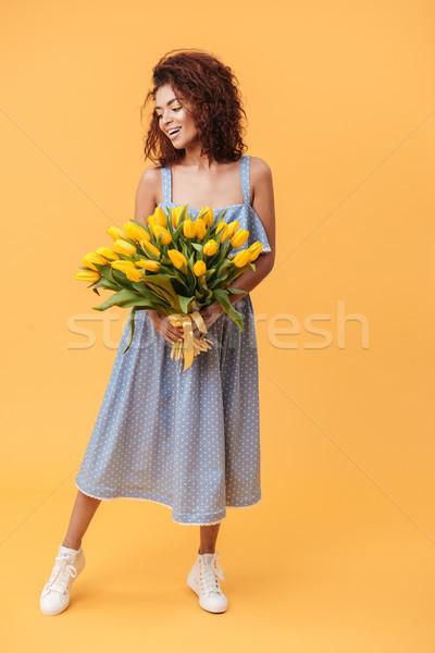 Portret glimlachend afrikaanse vrouw boeket Stockfoto © deandrobot