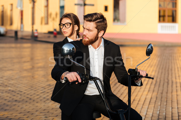 Careful business couple rides on modern motorbike in park Stock photo © deandrobot