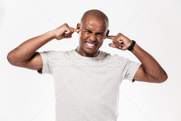 Africaine homme oreilles bruit image Photo stock © deandrobot