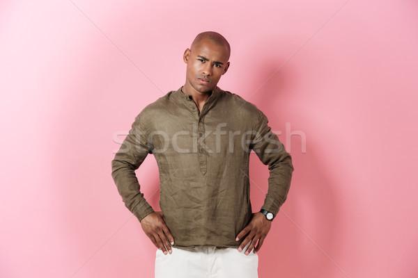Sérieux africaine homme bras hanches Photo stock © deandrobot