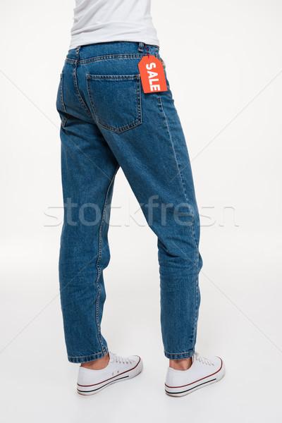 портрет женщины ног джинсов продажи Сток-фото © deandrobot