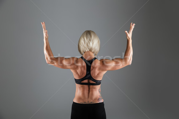 Back view portrait of a muscular strong sportswoman Stock photo © deandrobot