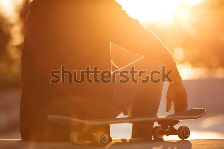 Stock photo: Close up of a male teenager having break while sitting