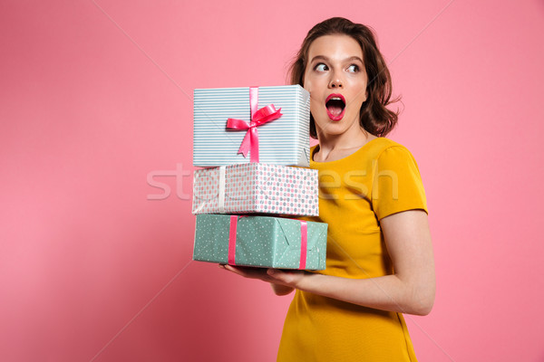 Close-up portrait of shocked pretty girl with bright makeup hold Stock photo © deandrobot
