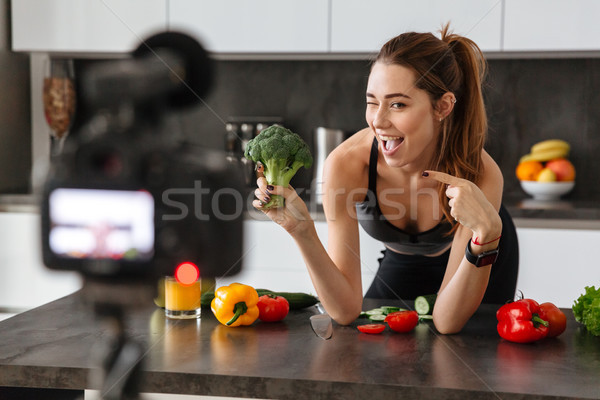 Happy healthy young girl recording her blog episode Stock photo © deandrobot