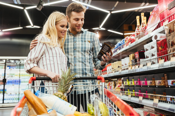 Couple shopping in supermarket Stock photo © deandrobot