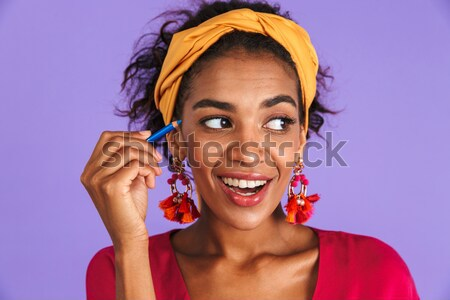 Closeup image of happy mulatto woman with colorful makeup laughi Stock photo © deandrobot