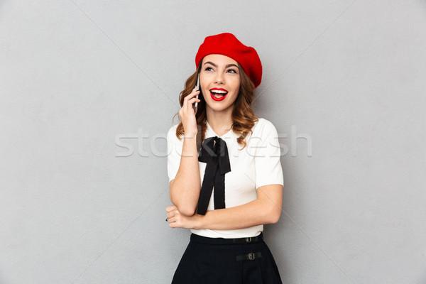 Portret uczennica uniform mówić telefonu komórkowego Zdjęcia stock © deandrobot