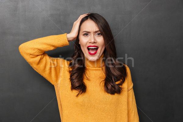 怒っ ブルネット 女性 セーター 頭 ストックフォト © deandrobot
