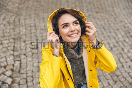 Portrait of beautiful female 20s walking on paving stones with m Stock photo © deandrobot