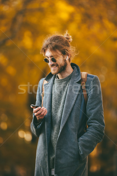 Portrait of a smiling bearded man Stock photo © deandrobot
