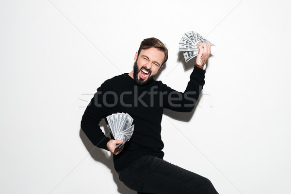Portrait of a cheery successful man Stock photo © deandrobot