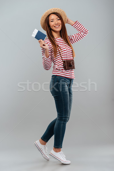 Full length image of Smiling asian woman in sweater Stock photo © deandrobot