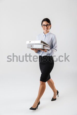 Portrait of a happy smiling man in white t-shirt Stock photo © deandrobot