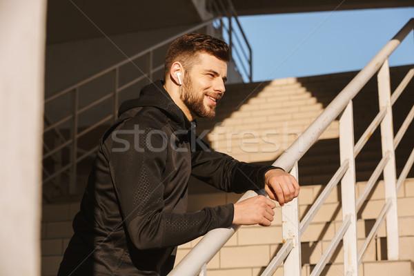 улыбаясь молодые спортсмен Сток-фото © deandrobot