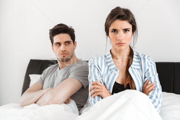 Disappointed young couple having a conflict Stock photo © deandrobot
