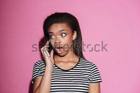 Surprised brunette woman in casual clothes posing Stock photo © deandrobot