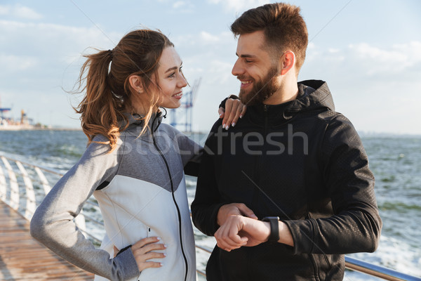 Happy young sports couple talking Stock photo © deandrobot