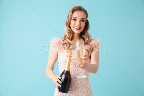 Happy blonde woman in dress posing with champagne Stock photo © deandrobot