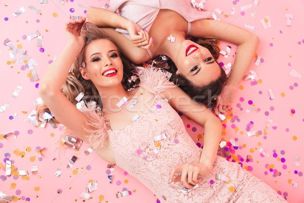 Image of glamorous blond and brunette women in dresses smiling a Stock photo © deandrobot