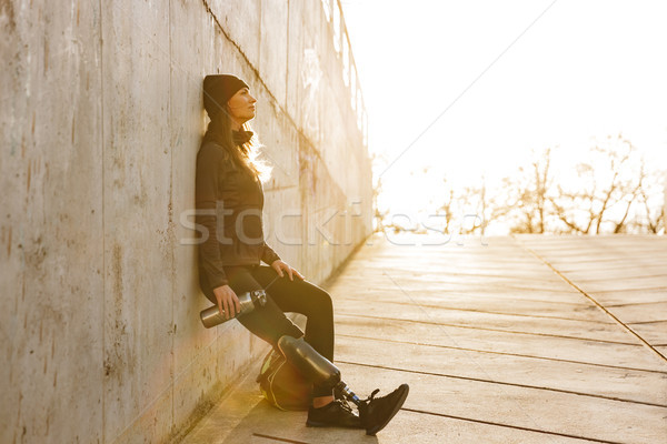Photo of athletic disabled girl with bionic leg in sportswear, s Stock photo © deandrobot