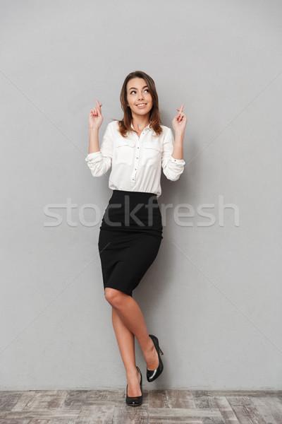 Belle nerveux femme d'affaires plein d'espoir geste Photo stock © deandrobot