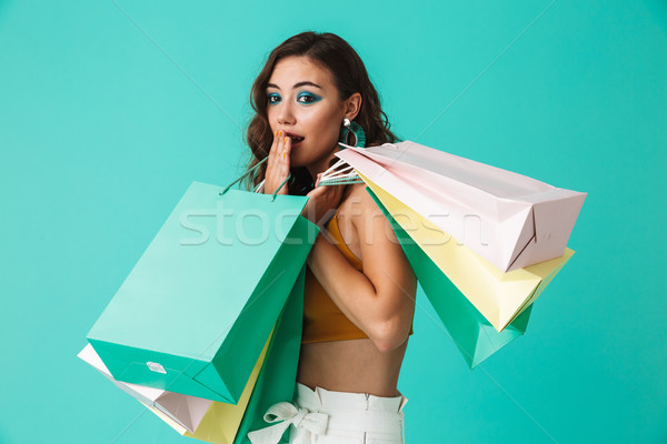 Photo of shopaholic girl 20s wearing fashion style holding color Stock photo © deandrobot