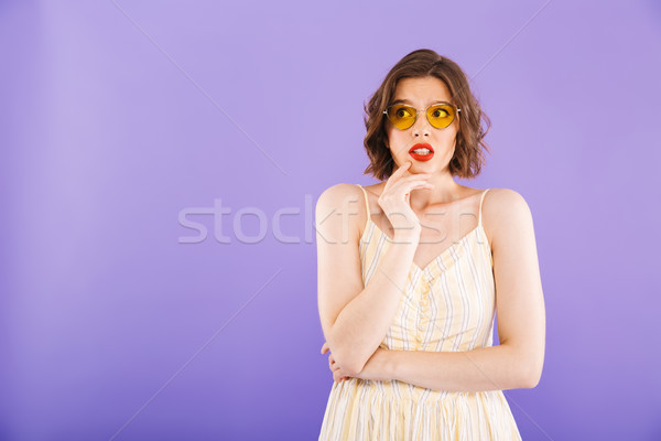 Portrait of a confused young woman dressed in summer Stock photo © deandrobot