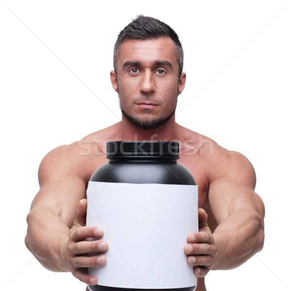 Sérieux musculaire homme jar protéines Photo stock © deandrobot