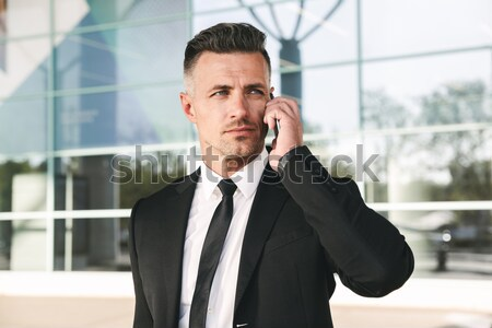 Pensive businessman standing at conference hall Stock photo © deandrobot