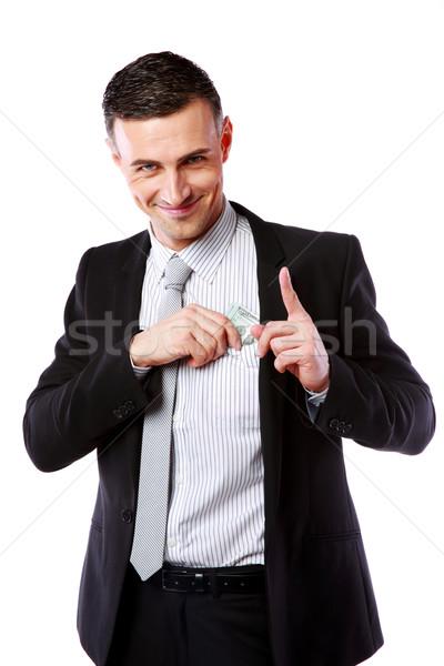 счастливым бизнесмен деньги кармана изолированный белый Сток-фото © deandrobot