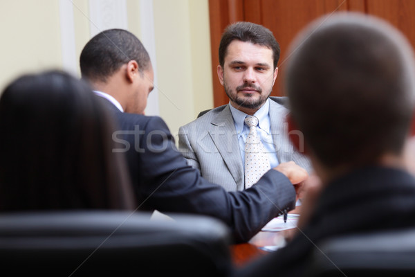 Mature businessman interviewing new people Stock photo © deandrobot
