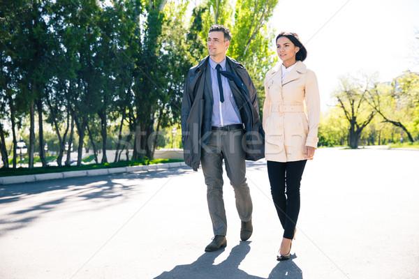 Beautiful couple walking in park Stock photo © deandrobot