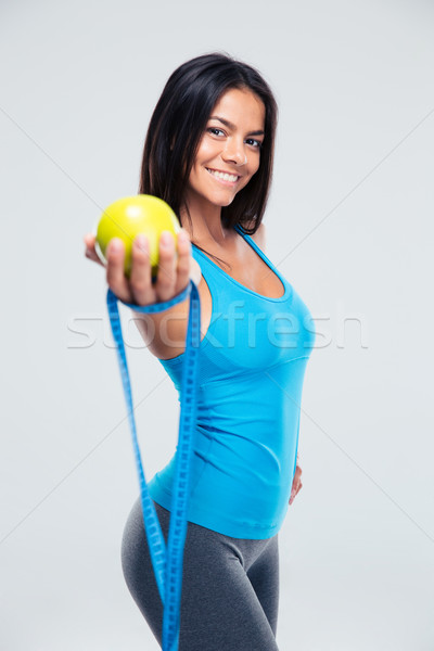 Deportivo mujer manzana cinta métrica mujer sonriente Foto stock © deandrobot