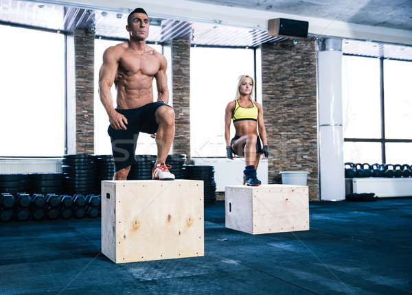 Group of man and woman working out with fit box Stock photo © deandrobot