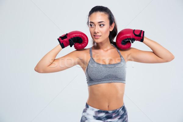 Portrait of a beautiful fitness woman  Stock photo © deandrobot
