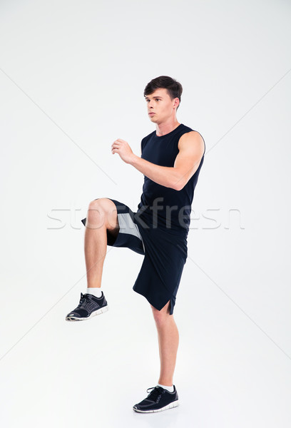Full length portrait of athletic man warming up Stock photo © deandrobot
