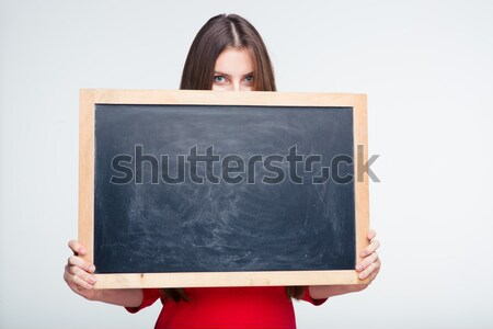 Woman peeping over white board  Stock photo © deandrobot