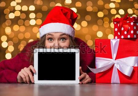 Komik güzel genç kadın gizleme arkasında tablet Stok fotoğraf © deandrobot