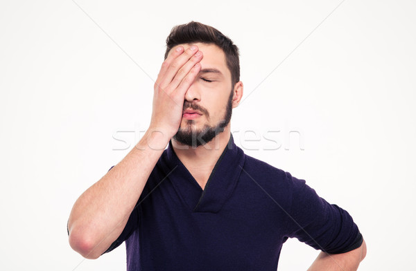Disappointed stressed bearded young man  with closed eyes Stock photo © deandrobot