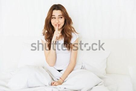 Mulher sessão cama travesseiro Foto stock © deandrobot