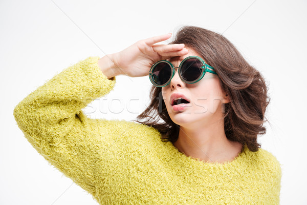 Woman in sunglasses looking into the distance  Stock photo © deandrobot