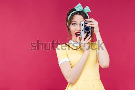 Playful funny young woman standing and posing with marmalade candies Stock photo © deandrobot