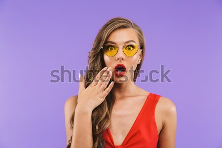 Funny comical young woman making mustache with chilli pepper Stock photo © deandrobot