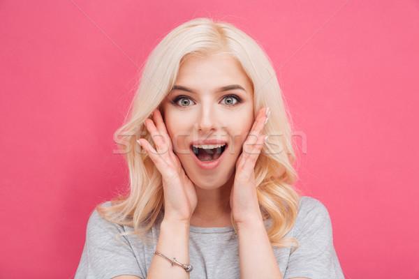 Meglepett csinos nő néz kamera rózsaszín lány Stock fotó © deandrobot